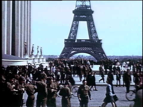 crowd of military servicemen of several nationalities and traffic driving in front of the eiffel tower / paris, france - french army stock videos & royalty-free footage