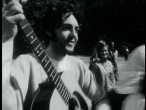 paul mccartney playing the guitar / india - paul mccartney stock videos and b-roll footage