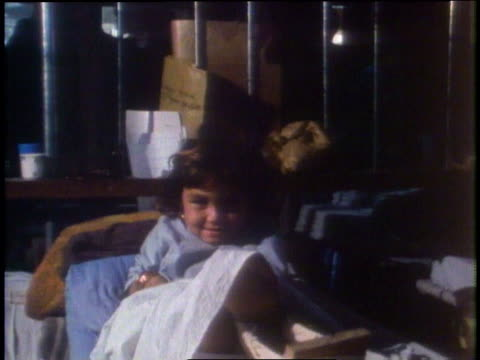 kirk douglas visits children in a hospital / peshawar, pakistan - pakistan stock-videos und b-roll-filmmaterial