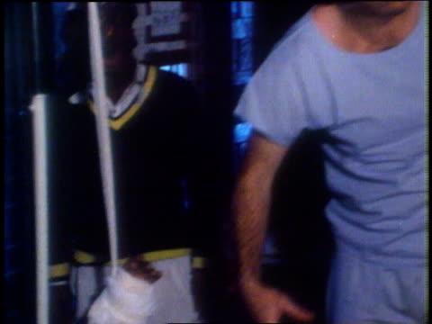 kirk douglas and doctor discussing a man's treatment / peshawar, pakistan - kirk douglas actor stock videos & royalty-free footage