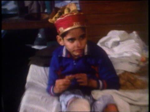 kirk douglas and doctor discussing a child's injuries / peshawar, pakistan - peshawar stock videos & royalty-free footage