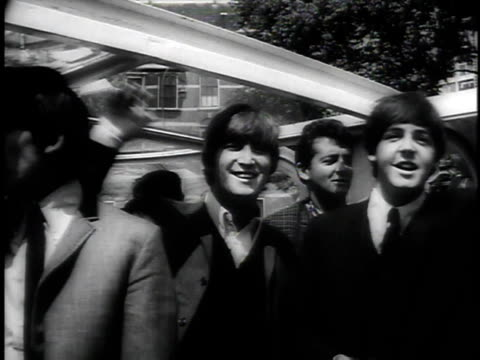 june 11 1964 montage beatles riding on boat in canal waving to screaming teenage fans some trying to swim to them police pulling them out of the... - 1964 bildbanksvideor och videomaterial från bakom kulisserna