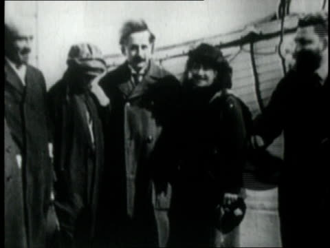 1920s MONTAGE Albert Einstein standing on deck of a ship
