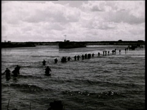 british troops wading ashore to utah beach / normandy, france - 1944 stock videos & royalty-free footage