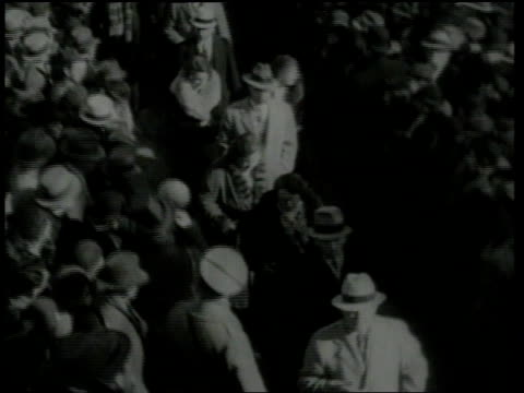 vídeos de stock e filmes b-roll de february 13, 1935 montage crowds of people standing outside courthouse as the lindberghs enter / flemington, new jersey, united states - 1935