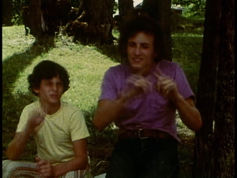 1980s deaf teenage boys speaking and signing at swan lake camp / pengilly, minnesota, united states - sign stock videos & royalty-free footage