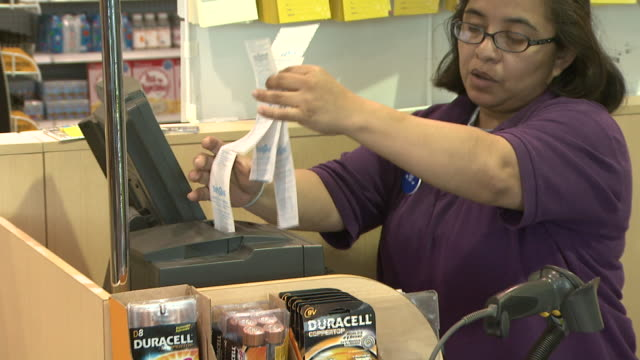 november 24 2009 zo cashier pulling receipts from register and completing sale at toys r us / united states - receipt stock videos & royalty-free footage