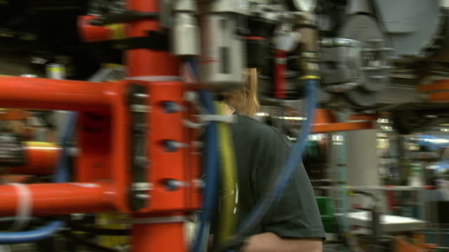 november 19 2008 ts general motors assembly line employee operating automated equipment / lansing michigan united states - lansing stock videos and b-roll footage