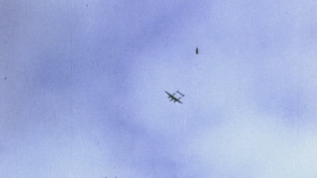 and raf spitfire fighters flying overhead as u.s. army soldiers watch / tunisia - raf stock videos & royalty-free footage