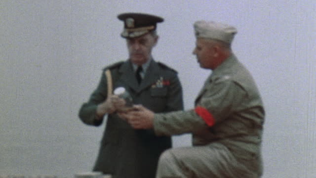 Admiral Leahy and Colonel Wharton talk to each other behind a display table / Camp Pendleton California United States
