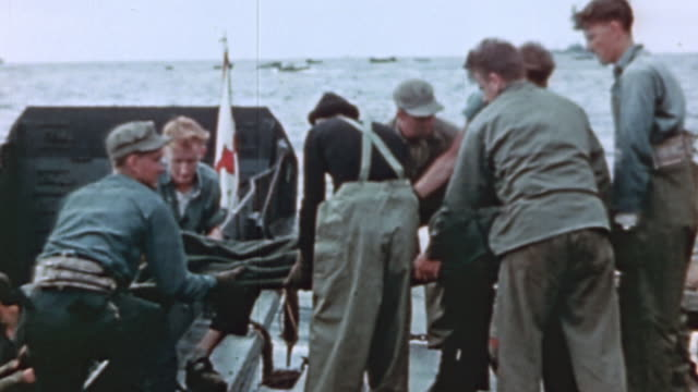 navy sailors transferring casualties strapped into stretchers from ship to ship during world war ii pacific campaign - world war ii video stock e b–roll