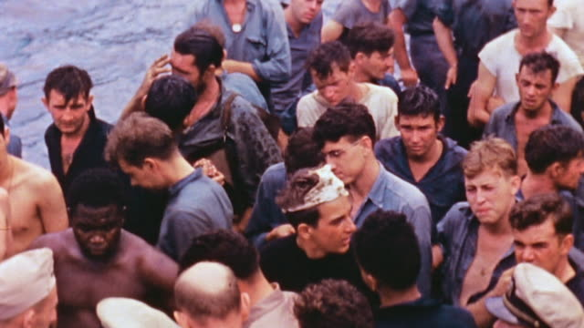 vídeos de stock e filmes b-roll de crew gathering on deck of uss nicholas watching survivors of the sunken uss helena preparing to transfer off the ship - pacific war