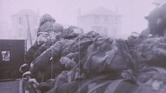 soldiers going ashore on dday disembarking landing craft and advancing on the beach / normandy france - d day stock videos & royalty-free footage