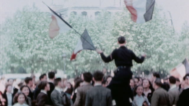 politician holding french flags and residents singing / paris france - ve day stock-videos und b-roll-filmmaterial