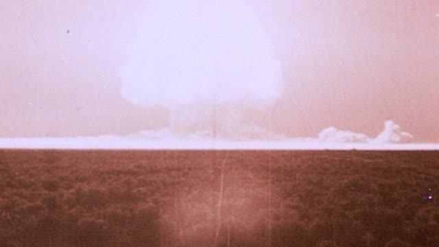 The world's first mushroom cloud as the Gadget explodes during the Trinity nuclear test / New Mexico United States