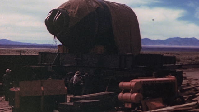 the jumbo device prior to the trinity nuclear test on railroad car being photographed and being maneuvered into position / new mexico united states - white sands missile range stock videos & royalty-free footage
