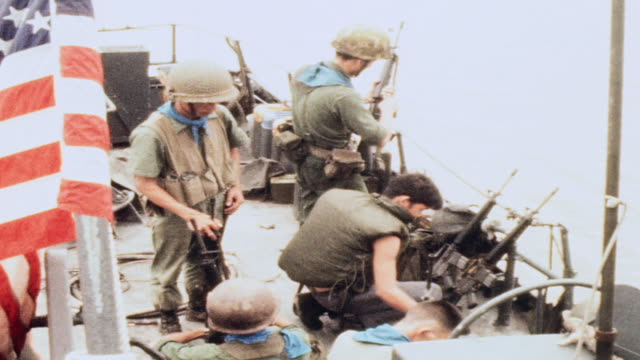 soldiers cleaning m16 rifles on deck of pcf / vietnam - m16 stock videos & royalty-free footage