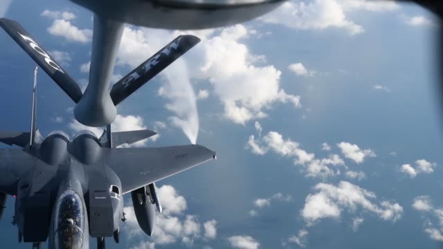 100th Air Refueling Wing KC135 Stratotanker refuels F15E Strike Eagles from the 48th Fighter Wing RAF Lakenheath on January 23 2019