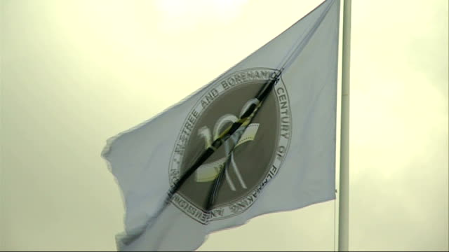 100th anniversary of elstree studios; hertfordshire: borehamwood flag flying at elstree studios - ボーハムウッド点の映像素材/bロール