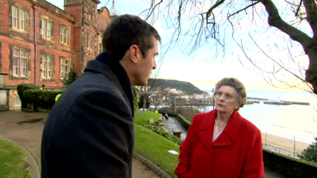 100th anniversary of scarborough world war i bombardment town of scarborough pan margaret fletcher margaret fletcher interview sot - 英国スカーブラ点の映像素材/bロール