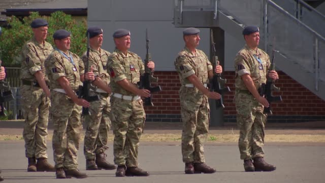 raf airmen prepare for parade england london ruislip raf northolt ext drum with royal crest and 'royal air force' painted on / raf airmen practising... - 式典点の映像素材/bロール