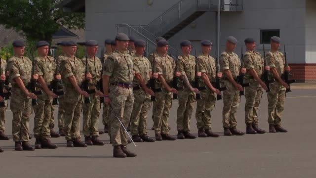 stockvideo's en b-roll-footage met raf airmen prepare for parade england london ruislip raf northolt ext various of raf airmen drilling on parade ground and rehearsing colours ceremony - britse leger