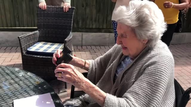 year-old wwii veteran claims medals 75 years after service; england: essex: ext gv jacqueline dyde saluting naval officer as sitting at table in... - war and conflict stock videos & royalty-free footage