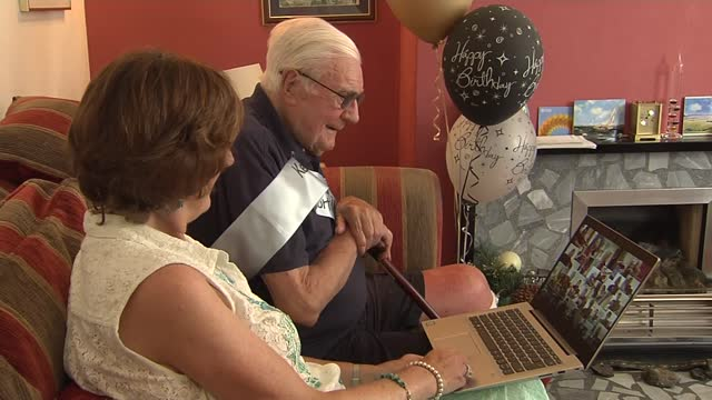 year-old viola player ken essex completes 10k charity walk; england: ext various of ken essex and lady on couch looking at laptop on which musicians... - sofa stock videos & royalty-free footage