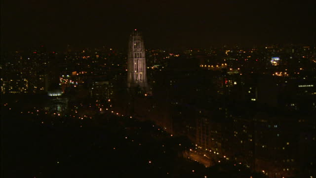 1080i hd aerial night xws lighted gothic steeple tower of riverside church moving north zi ws steeple passing steeple pan xws henry hudson parkway w/... - steeple stock videos & royalty-free footage