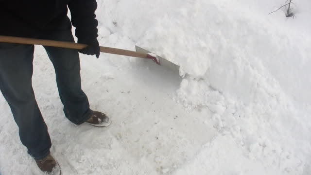 hd 1080i man shoveling snow 3 - spade stock videos & royalty-free footage