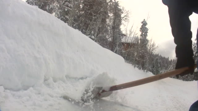 hd 1080i man shoveling snow 4 - spade stock videos & royalty-free footage