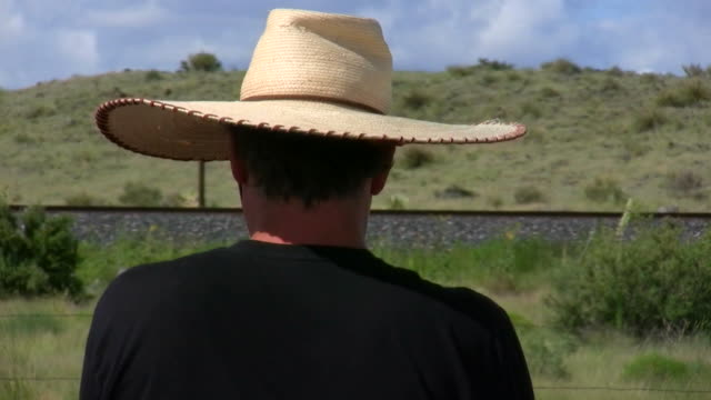 hd 1080i man wearing sombrero in the wind - sombrero stock videos & royalty-free footage