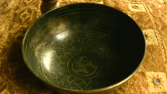 hd 1080i tibetan singing bowl with sound 1 - traditionally tibetan stock videos & royalty-free footage