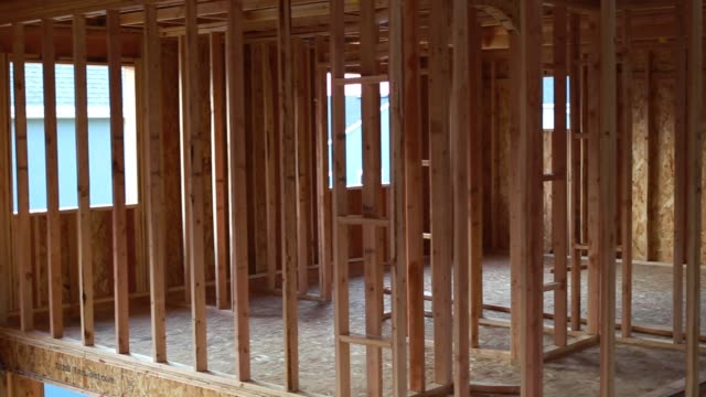 1080p footage of house construction framing - construction frame stock videos & royalty-free footage