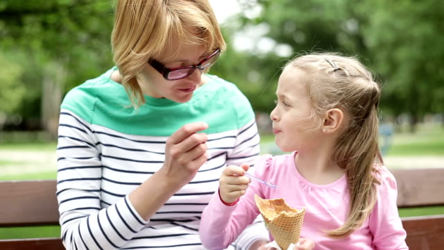 HD 1080p Mother and daughter eating ice cream
