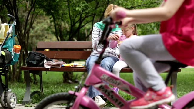 hd 1080p mother and daughter eating ice cream - park bench stock videos & royalty-free footage