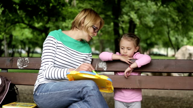 HD 1080p Mother and daughter playing in the park