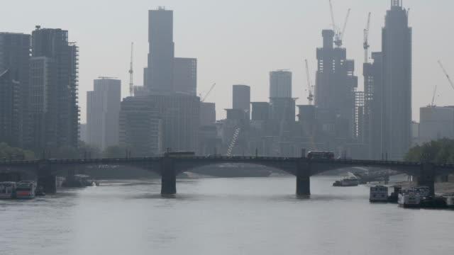 4k 10bit construction skyline cityscape of london vauxhall st georg wharf with st george wharf tower - mi6 stock-videos und b-roll-filmmaterial