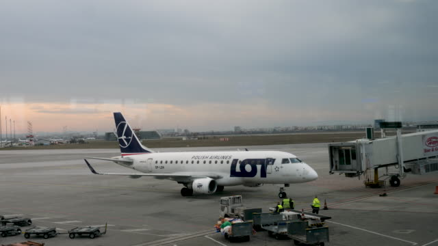 4k 10bit lot polish airlines b737 arriving at sofia airport in bulgaria - airplane hangar stock videos & royalty-free footage