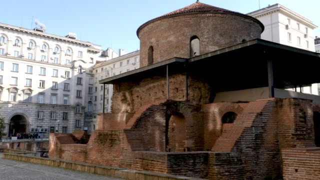 4k 10bit panning scene of the ruins of the st. george rotunda in sofia, bulgaria - temple building stock videos & royalty-free footage