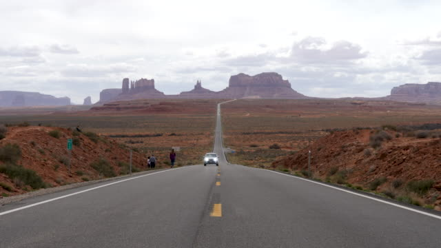 4k 10bit scene of monument valley looking south on us route 163 from north of the arizona utah state line / mexican hat, utah, usa - utah stock videos & royalty-free footage