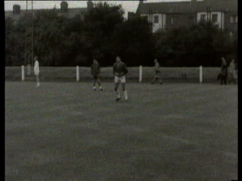 wembley stadium england team train bobby moore bobby charlton nobby stiles geoff hurst alf ramsey uruguayans training / london united kingdom - 1966 stock videos & royalty-free footage
