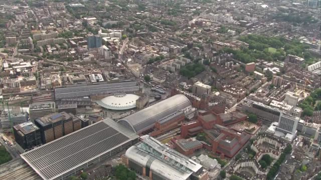 Aerials over London locations AIR VIEWS over London cityscape King's Cross Station concourse / King's Cross and St pancras stations / traffic along...