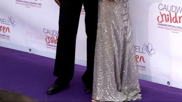 10th Anniversary Butterfly Ball for Caudwell Children's charity celebrity arrivals and interviews Liz Hurley arrival with husband Arun Najar posing...