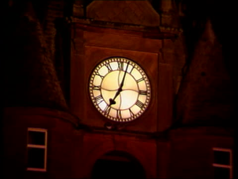 linda scotland lockerbie gv clock face on clock tower showing time at two minutes past seven gv clocktower with christmas tree seen below it - lockerbie stock videos & royalty-free footage