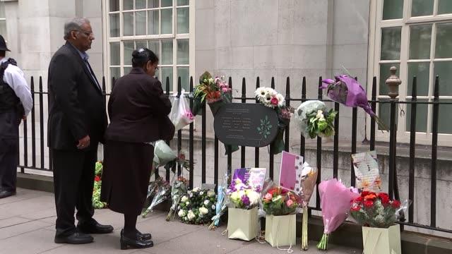Tavistock Square memorial service ENGLAND London Tavistcok Square EXT Various of people laying flowers at memorial plaque in Tavistock Square scene...