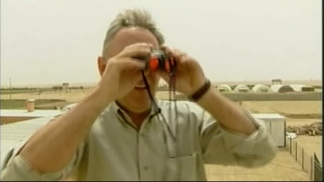 chelsey lloyd retraces father's final journey tx iraq near basra ext **austin interview overlaid sot** terry lloyd climbing ladder to roof and... - bassora video stock e b–roll