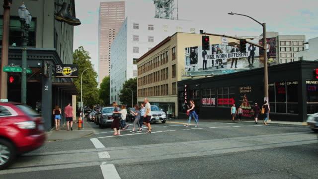 nw 10th avenue and burnside - portland street scene - urban road stock videos & royalty-free footage