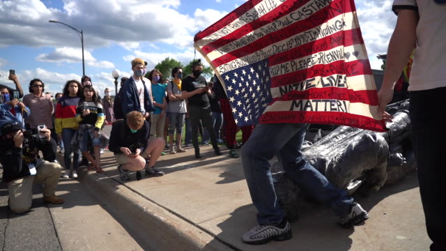 10th june 2020: protesters pulled down the columbus statue with ropes on minnesota state capitol grounds. native american activist / protestor holds... - statue stock videos & royalty-free footage