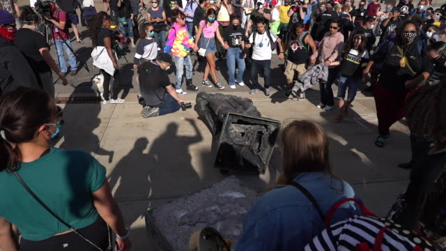 protesters pulled down the columbus statue with ropes on minnesota state capitol grounds native american activists dance and chant around the statue... - cristoforo colombo video stock e b–roll